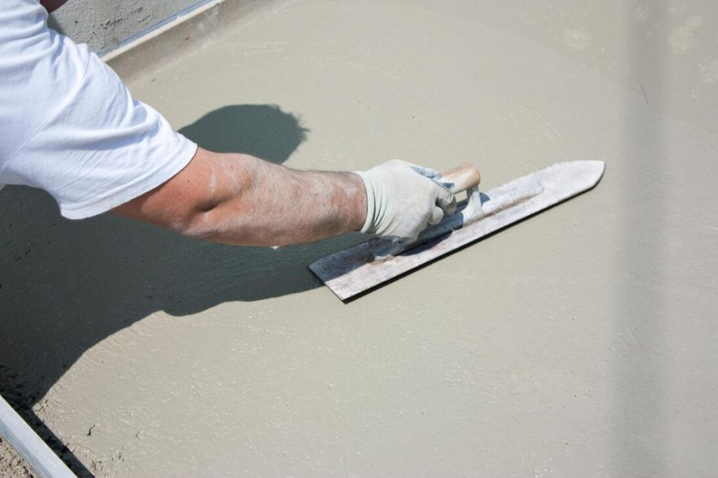 This Is A Picture Of Concrete Being Smoothed Out With A Hand Trowel By Concrete Contractors In Delaware County Pa